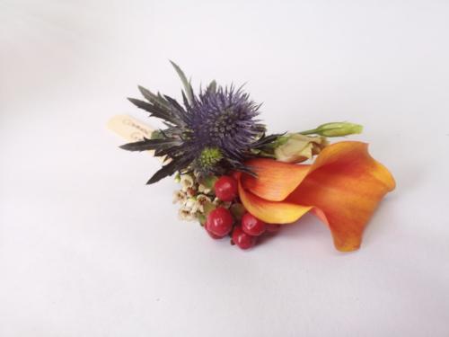 buttonhole-orange-calla-thistle-berries